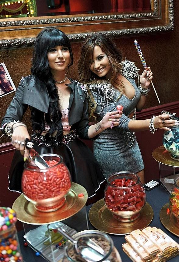 Demi and Hanna Beth at Sugar Factory table of goodies