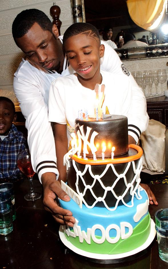 Diddy with son Christian as he blows out his candles