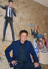 Iconic Variety Entertainer Donny Osmond Views His Caricature at The Palm Restaurant in Las Vegas