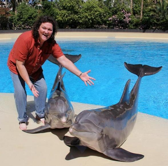Dot Marie Jones with dolphins Lightning and Osborne at Siegfried & Roy's Secret Garden and Dolphin Habitat at The Mirage