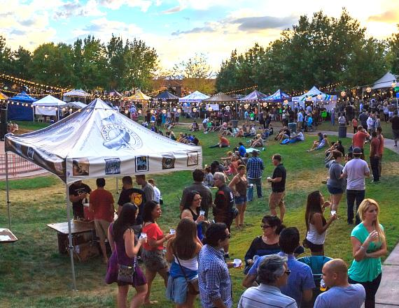 Festival-goers enjoying the 60+ breweries lining the Clark County Amphitheater at Motley Brews' 2014 Downtown Brew Festival