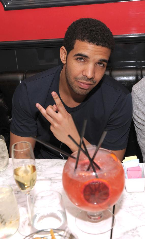 Drake with the 'Passion Punch' cocktail at Sugar Factory American Brasserie