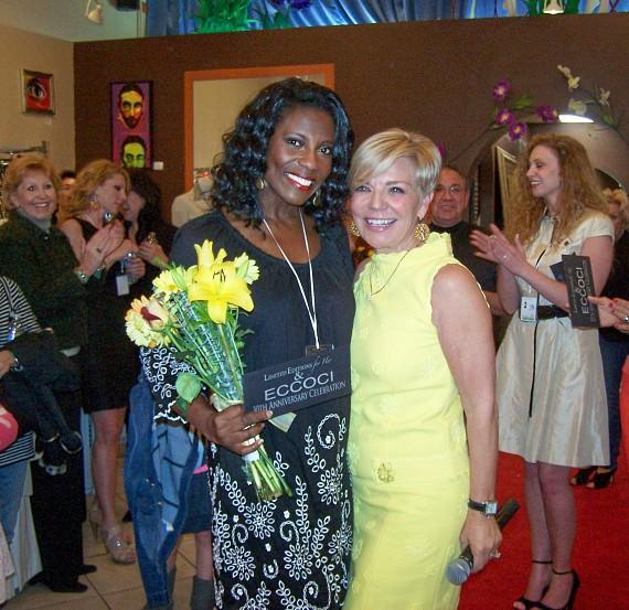 """ECCOCI """"Model of the Year"""" Terri Watts with store manager Janice Marie Wilson"""