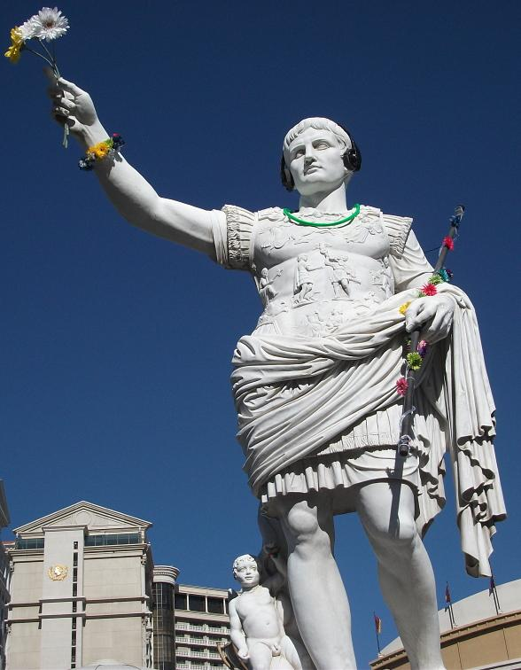 Caesar Augustus, first Emperor of the Roman Empire, welcomes EDC Festival goers in his best neon attire at the main entrance to Caesars Palace Las Vegas.