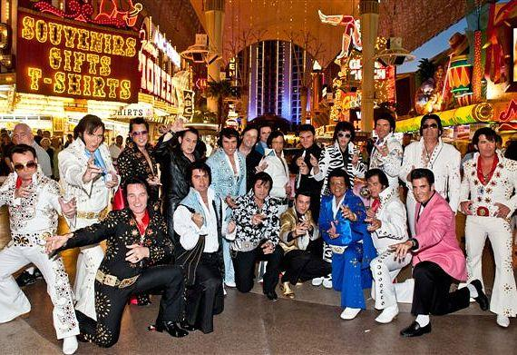 """The 21 """"Elvis"""" competitors parade at the start of the Third Annual Ultimate Elvis Tribute Artist Contest at Fremont Street Experience."""