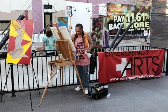 An artist from Emergency Arts performs live painting during the For the Love of Art event