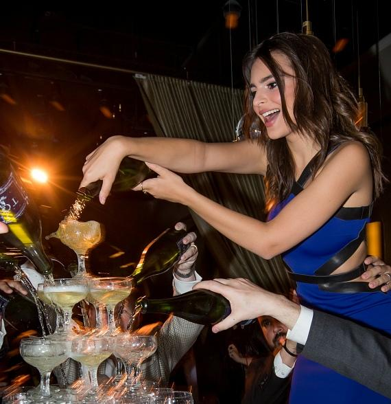 Emily Ratajkowski pours champagne over 385-glass tower during Condé Nast Traveler's 2014 Hot List Party