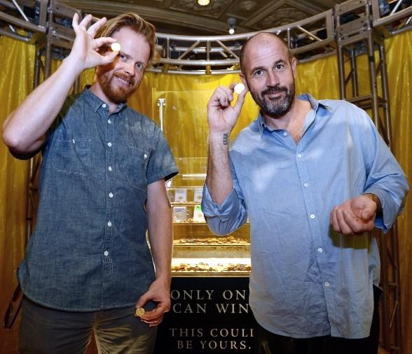 Co-Authors James Frey and Nils Johnson-Shelton stand in front of $500,000 of gold coins at Caesars Palace