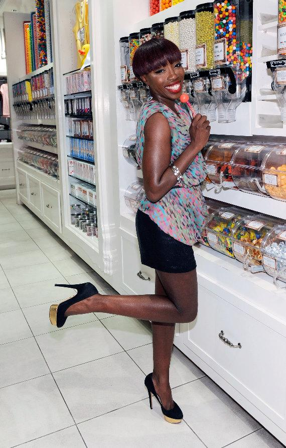 Estelle Poses with a Couture Pop at Sugar Factory