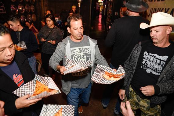 Evel Pie General Manager Joey D'Amore serves up slices to guests