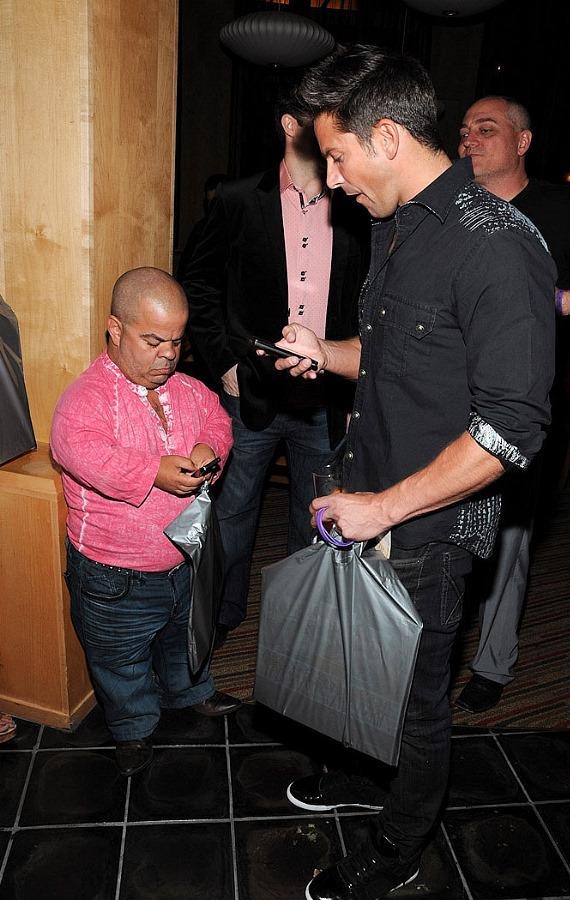 "Brian Thomas and Jeff Timmons check their phones at ""Ultimate FANTASY"" calendar party"