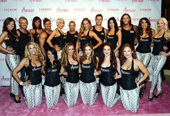 FANTASY ladies with the cast of Thunder From Down Under on the pink carpet