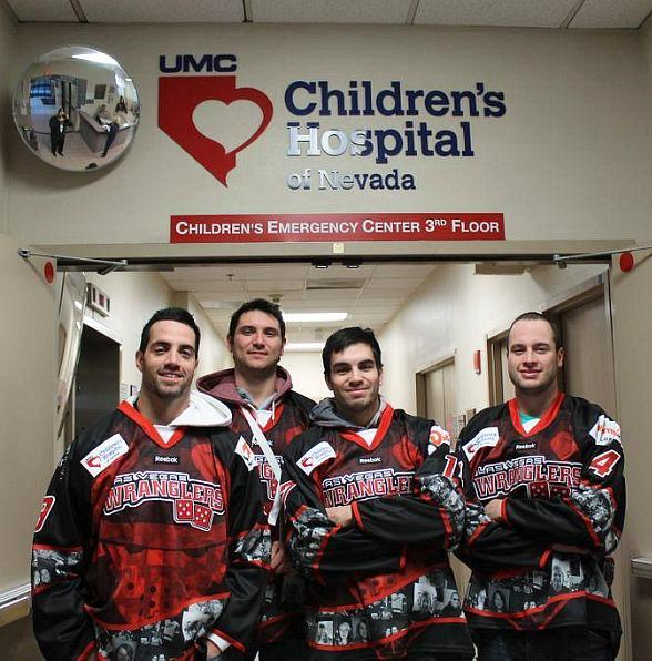 Wranglers (D) Mike Madill, (F) Sean Wiles, (F) Adam Huxley and (D) Josh Godfrey model the 10th FANniversary jerseys