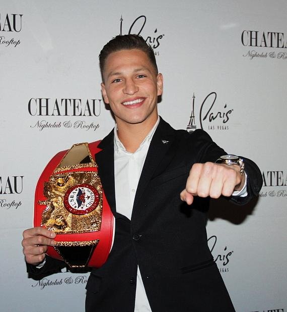 """Featherweight boxer Daniel """"Twitch"""" Franco with his first title belt"""