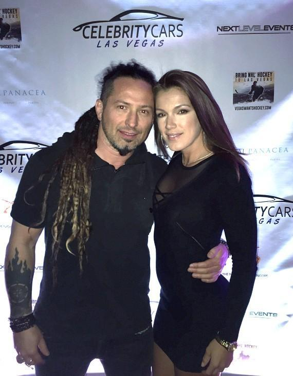 Five Finger Death Punch's Zoltan Bathory and date at Celebrity Cars Las Vegas grand opening