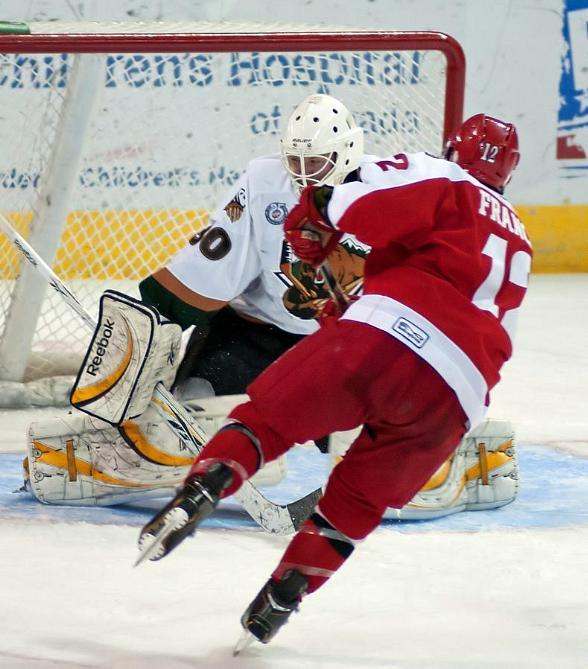 Wranglers center Chris Francis snipes the puck past Utah in a shootout win