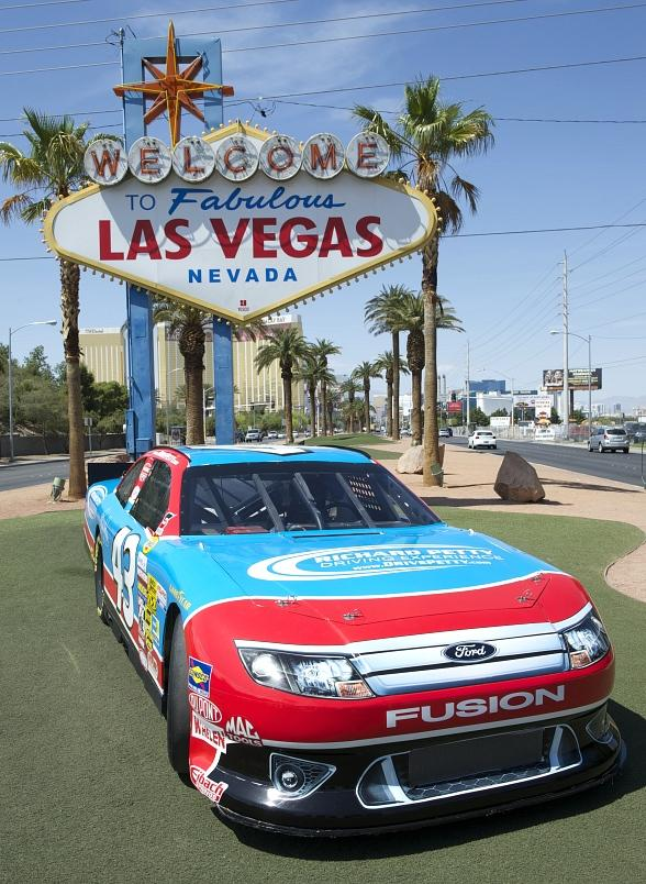 Richard Petty Driving Experience Displays NASCAR Car at Las Vegas Sign for National Travel & Tourism Week