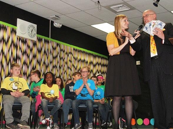 Students with Magician Adam London and wife Alana London, a teacher at Brookman Elementary School