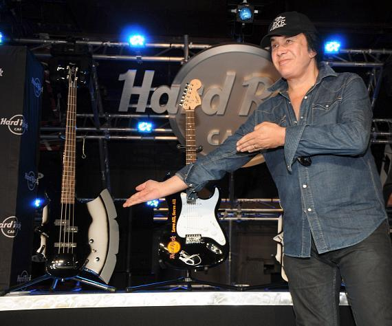 Gene Simmons points to bass guitar