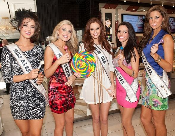 Miss USA contestants and Alyssa Campanella pose at Sugar Factory in Las Vegas with Couture Pops