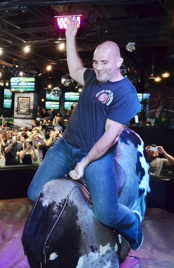 Glover Teixeira rides Rockhouse's mechanical bull