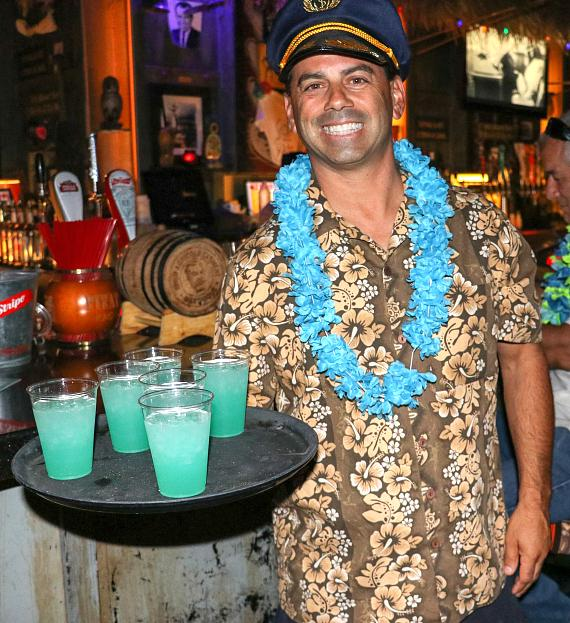 Golden Tiki General Manager Joey D'Amore serves tiki punch to guests.