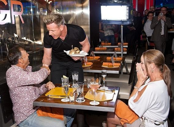 Gordon Ramsay celebrates the recipients of the one millionth burger at Gordon Ramsay BurGR at Planet Hollywood Resort & Casino