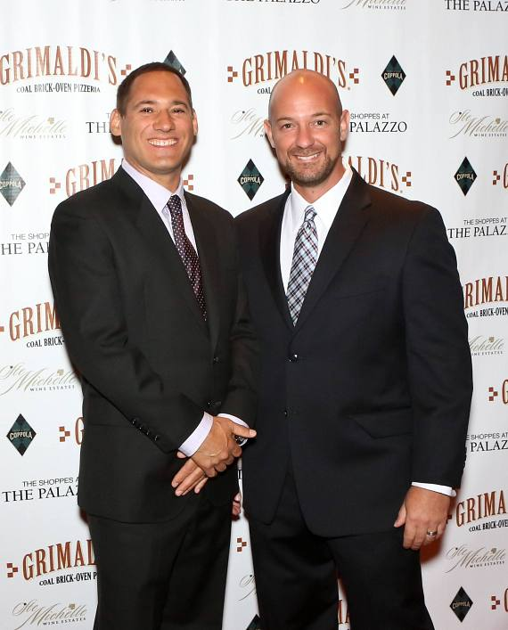 Grimaldi's Pizzeria CEO and President, Joey Ciolli and COO, Eric Greenwald pose on the red carpet at the grand opening of Grimaldi's Pizzeria inside The Shoppes at The Palazzo on Sunday, July 29.