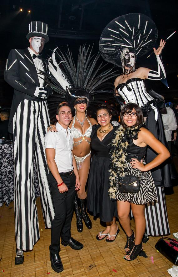 Guests and stilt performers