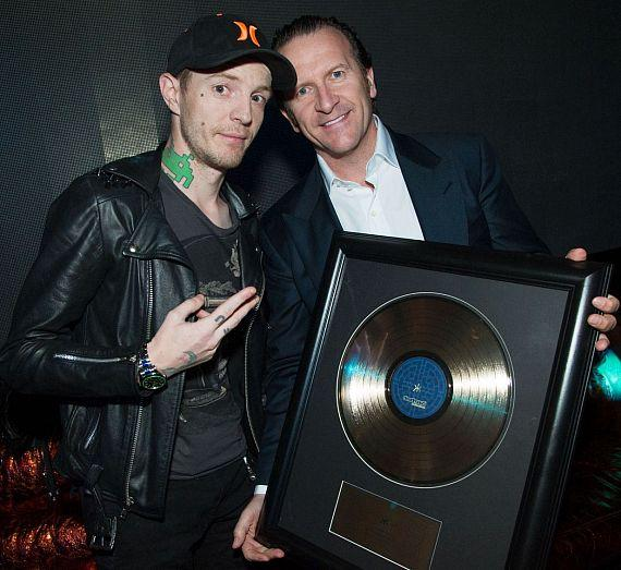 Neil Moffitt presents gold disc to deadmau5Neil Moffitt