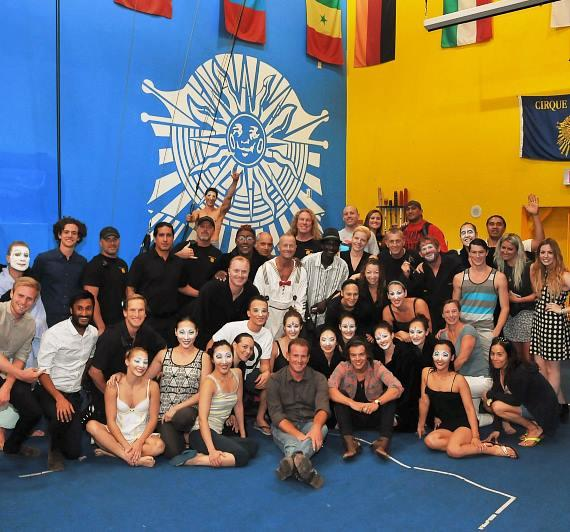 "Harry Styles of One Direction visits with the cast of ""O"" by Cirque du Soleil on Thursday, Aug. 2"