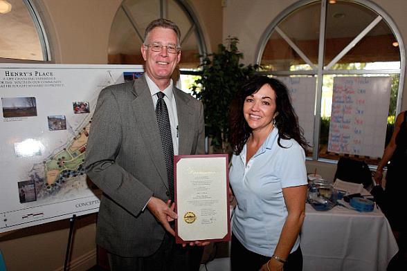 "City of Henderson Mayor Andy A. Hafen, pictured here with Dawn Prendes (Sgt. Prendes' widow), proclaims today, May 21, 2010, ""Henry's Place Day"" in honor of Sgt. Henry Prendes"