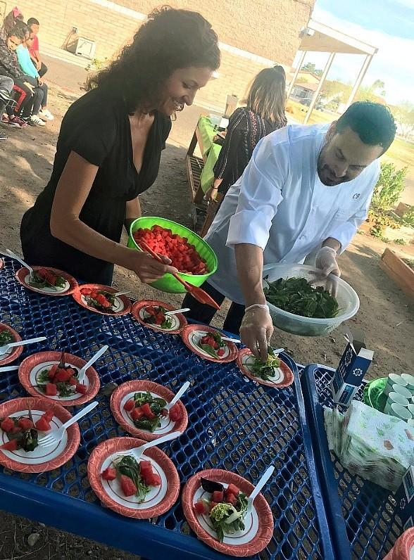 "Chef Carlos Buscaglia of Hexx Kitchen + Bar Teaches Students Healthy Recipes in ""Green Our Planet's Chef-To-School Program"""