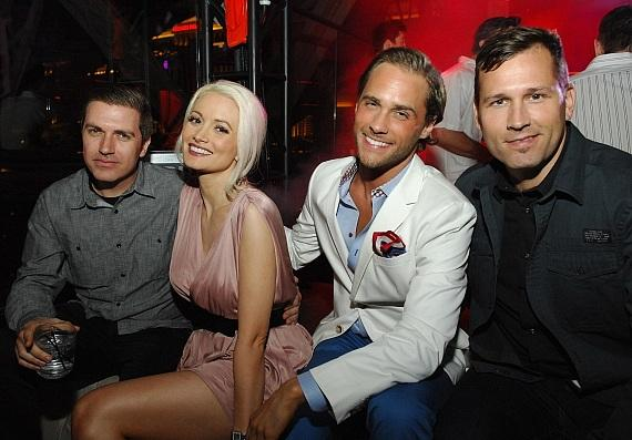 Pasquale Rotella, Holly Madison, Josh Strickland and Kaskade pose at their VIP table at Bazaar inside Chateau Nightclub & Gardens in Las Vegas