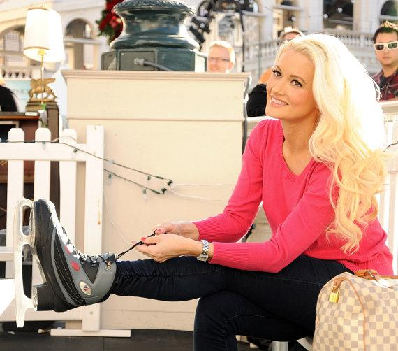 Holly Madison laces her ice skates