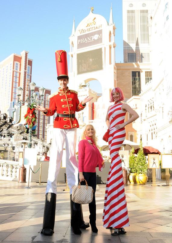 Holly Madison with Winter in Venice stilt walkers