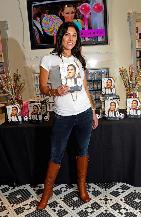 Hope Solo with memoir inside Sugar Factory