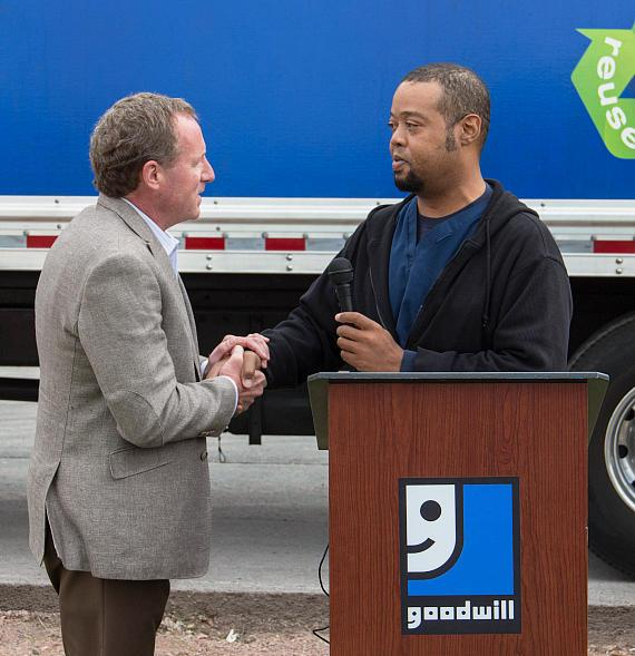 Steve Chartrand, President & CEO of Goodwill of Southern Nevada shakes the hand of Damian Edmond, a dialysis patient. Goodwill helped pay for Edmond's training and education after he lost his job. Edmond is now employed and helping others who, like him, are waiting for a kidney transplant.