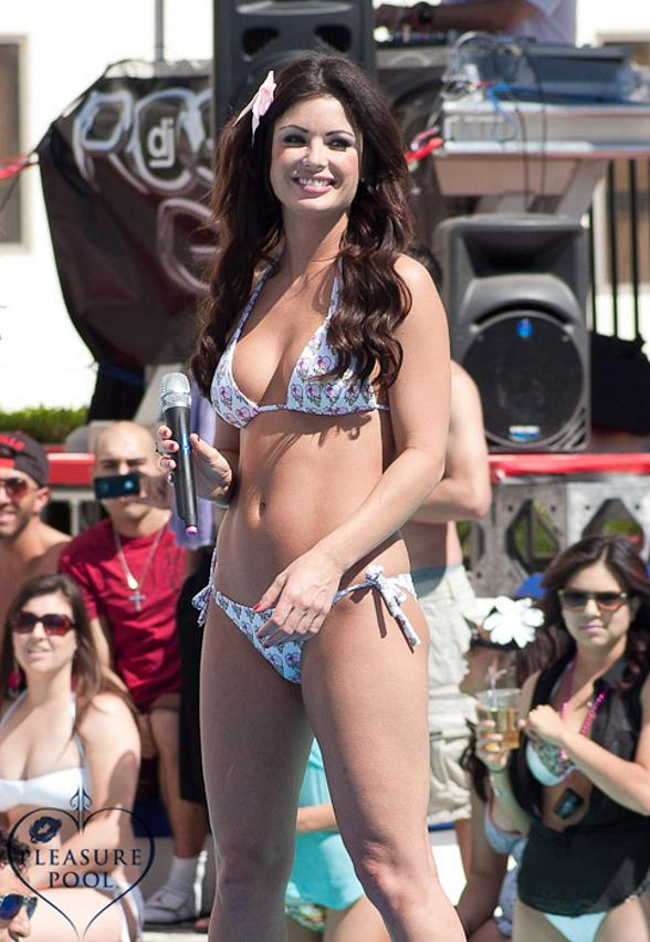 Laura Croft hosting the Miss Pleasure Pool Bikini Contest