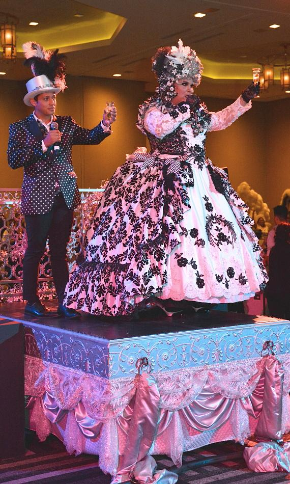 Hosts Norma Llyaman and Miguel Martinez-Valle lead the crowd in a toast