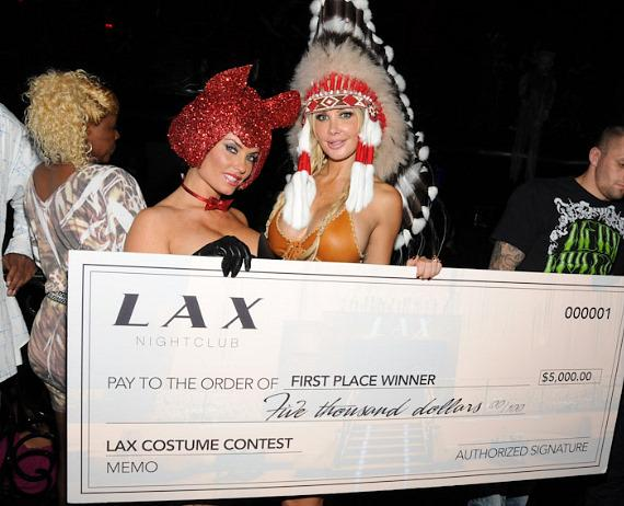 CoCo presents check to best costume winner at LAX Nightclub in Las Vegas
