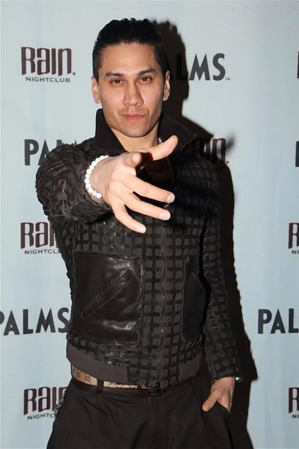 Taboo from The Black Eyed Peas on red carpet at Rain Nightclub