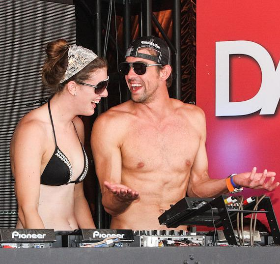 Olympic gold medalist Allison Schmitt with Michael Phelps in DJ booth at Encore Beach Club