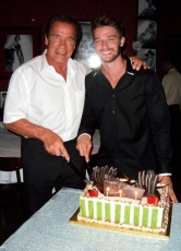 Arnold Schwarzenegger and Patrick Schwarzenegger at Strip House in Planet Hollywood Resort & Casino