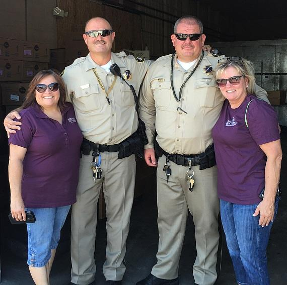 Ida Maese (left) and event organizer Diane Ray (right) coordinated the water delivery with volunteers and representatives of the Las Vegas Metro Police Department