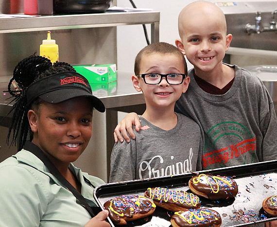 Gavin Prince (r), along with his brother Brendan and Krispy Kreme employee