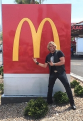 Marcus Collins of The Texas Tenors surprises customers with a song at McDonald's