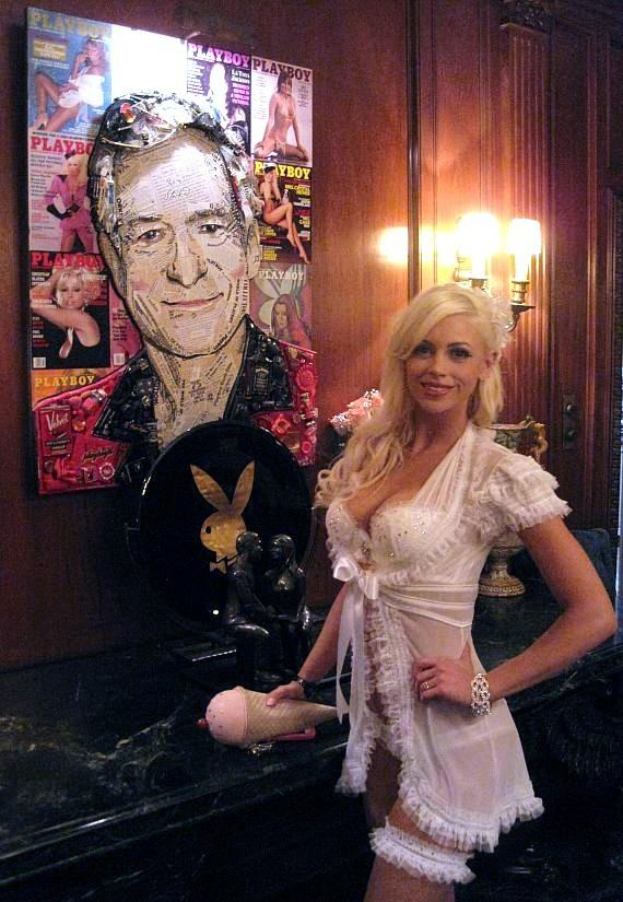 Chloe Crawford with portrait of Hugh Hefner at Playboy Mansion