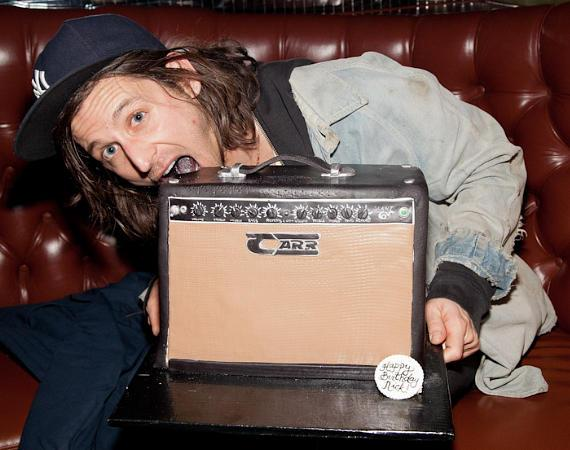 Nick Valensi with birthday cake at Body English Nightclub