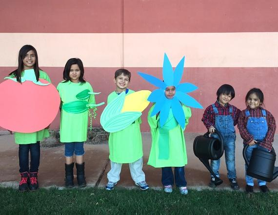 Children Lynette, Roxi, Alex, Andrea, Max and Rhiana dress up in garden theme to plant the first seeds at Lied Memorial Clubhouse